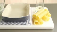 Cannelloni, a baking dish and a spinach-ricotta mixture Stock Footage