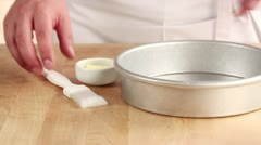 A pie dish being brushed with soft butter Stock Footage