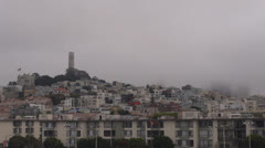 Coit Tower and Telegraph Hill in foggy day, San Francisco Port, CA, USA Stock Footage