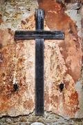 Cross on a grunge wall Stock Photos