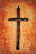 Cross on a grunge wall Stock Photos