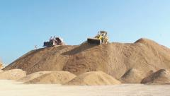 Bulldozers moving dirt on a dirt hill Stock Footage