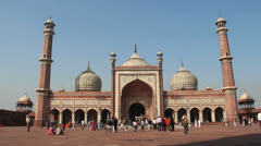 Delhi Friday Mosque with pilgrims and tourists c1 Stock Footage