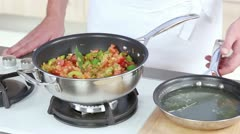 Stock being added to a rice and vegetable stew Stock Footage