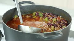 A ladle in a pot of chilli con carne Stock Footage
