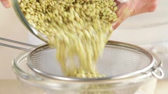Draining lentils - stock footage
