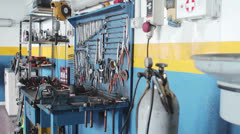 workbench of a auto mechanic - mechanic's workshop - garage - car repair shop - stock footage