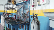 Stock Video Footage of workbench of a auto mechanic - mechanic's workshop - garage - car repair shop
