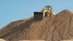 Bulldozers moving sand on a sand hill MS Stock Footage