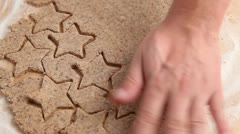 Cutting out cinnamon stars Stock Footage