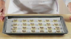 Raw chocolate and vanilla biscuits on a baking tray Stock Footage