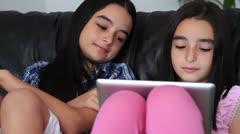 Happy teenage girls having fun using tablet computer - stock footage