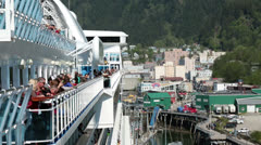 Cruise ship passengers on deck Juneau Alaska port HD 6970 Stock Footage
