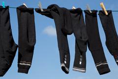 Socks on a washing line Stock Photos