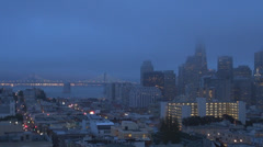 Aerial view of Financial District,San Francisco Port,Bay Bridge twilight Stock Footage