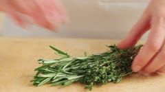 Picking rosemary leaves from stems Stock Footage