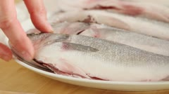 Seasoning a cleaning fish with salt Stock Footage