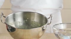 Beating creme in round-bottomed metal mixing bowl Stock Footage