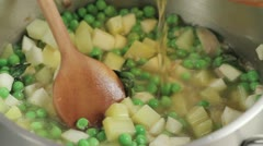 Pouring stock into pea soup Stock Footage