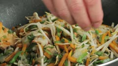 Seasoning stir-fried vegetables with pepper - stock footage