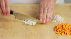 Stock Video Footage of Garlic being finely chopped