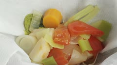 Vegetable stock being sieved Stock Footage