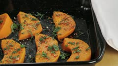 Spiced pumpkin wedges on a baking tray Stock Footage