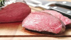 Sliced, rare roasted venison saddle fillet - stock footage