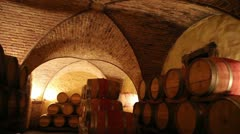 Barrels in a wine cellar at the Skoff winery in Gamlitz, Sudsteiermark, Austria - stock footage
