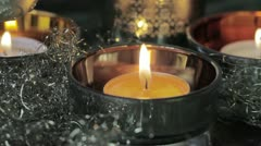 A burning tealight with Christmas decorations Stock Footage