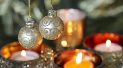 Christmas baubles and tealights - stock footage