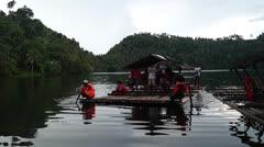 passenger bamboo raft - stock footage