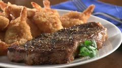 Surf and Turf (grilled beef steak and prawns) Stock Footage