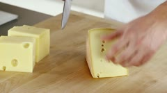 Rind being cut off a piece of cheese being - stock footage