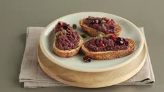 Crostini with olive paste - stock footage
