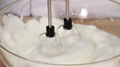 Egg whites being beaten and sugar being added Stock Footage