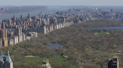 Aerial View of Central Park Meadow and Lake Manhattan Skyscrapers, New York City Stock Footage