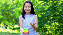 Beautiful little girl playing with colorful plastic spring toy Stock Footage