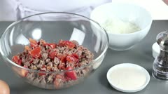 Stock Video Footage of Grated cheese being added to a minced meat and tomato mixture