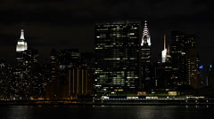 Empire State Building, UN Plaza, Illuminated NYC Skyline, by night, Chrysler Stock Footage