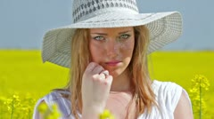 Beautiful woman with innocent look posing - stock footage