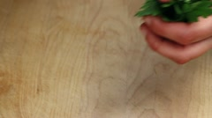 Coriander and parsley being chopped - stock footage