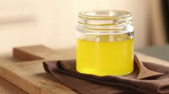 A jar of ghee (clarified butter) - stock footage