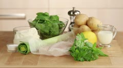 Ingredients for fish pie (fish fillet, creme fraiche, spinach and potatoes) - stock footage