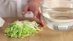 Leek being blanched Stock Footage