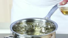 An egg being poached in vinegar water - stock footage