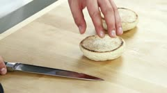 English muffins being halved - stock footage