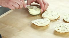 Halved English muffins being spread with butter - stock footage