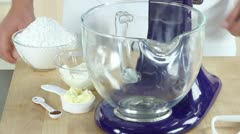 Ingredients for cream cheese creme being placed in a mixing bowl Stock Footage