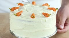 A carrot cake with cream cheese frosting being sliced (USA) Stock Footage